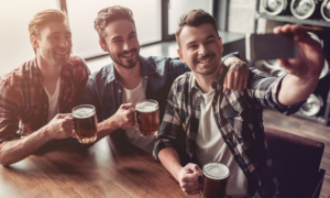guys drinking beer in a bar