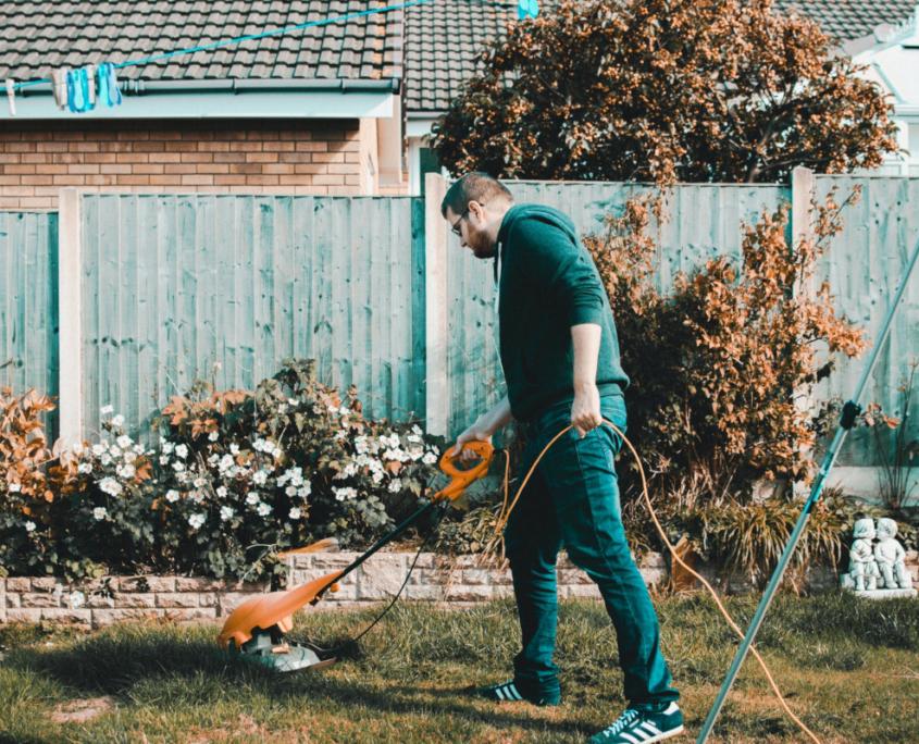 Husband vacuuming backyard