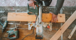 A man using a circular power saw