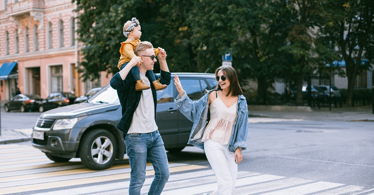 Happy family crossing streets