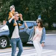 Happy family crossing streets