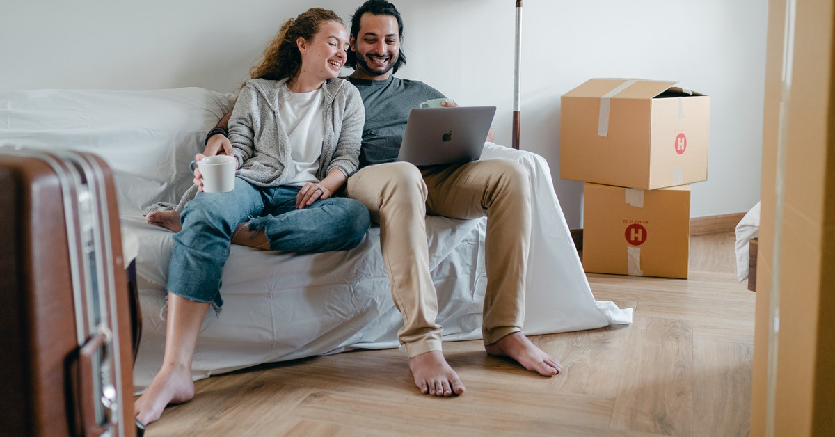 Couple packing and moving out